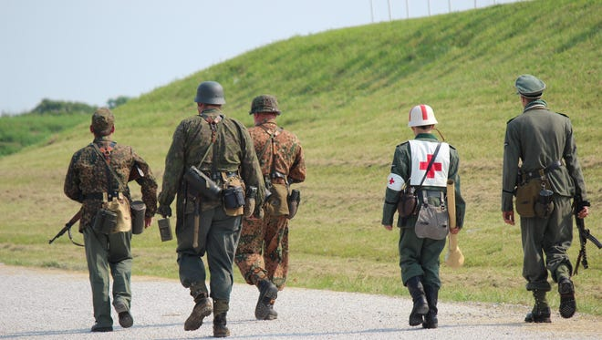 Military historians performed a World War II reenactment at the First Shot Ceremony of the National Matches at Camp Perry.