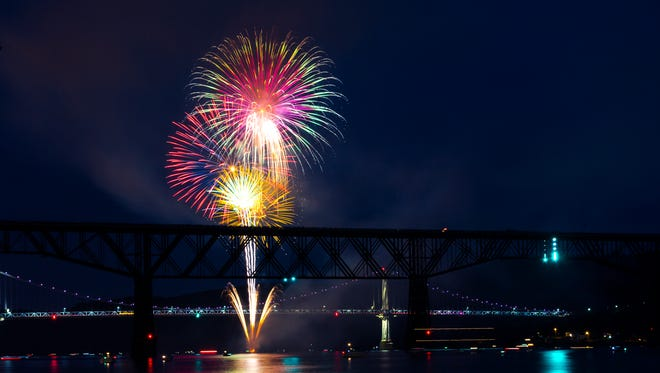 Seen from the Hudson River Rowing Association Boathouse in Poughkeepsie, fireworks illuminate the Walkway Over the Hudson in celebration of the Fourth of July.