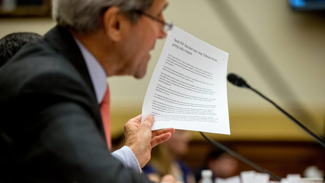 Secretary of State John Kerry holds up an article as he testifies July, 28, 2015, on Capitol Hill in Washington, D.C., before the House Foreign Affairs Committee hearing on the Iran Nuclear Agreement.