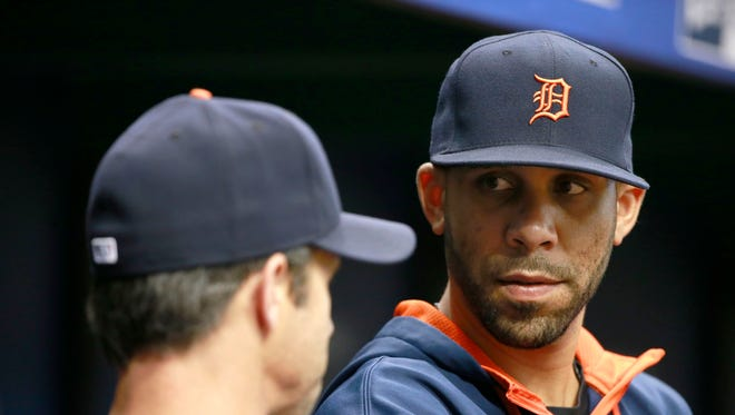 Jul 29, 2015; St. Petersburg, FL, USA; Detroit Tigers pitcher David Price (14) talks with manager Brad Ausmus (7) in the dugout against the Tampa Bay Rays at Tropicana Field.