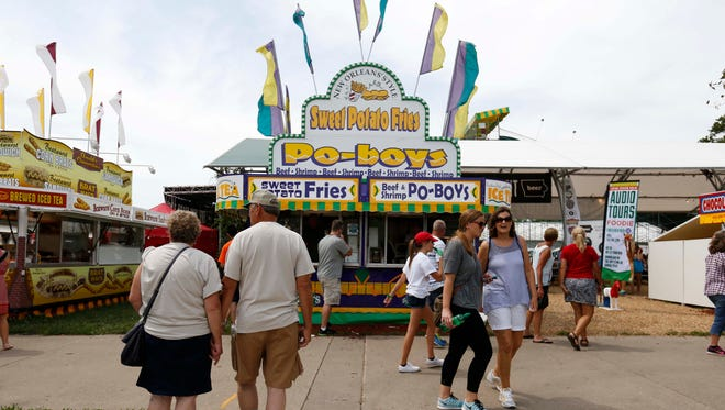Fair goers try to make their food selections Thursday, Aug. 13, 2015, during opening day at the Iowa State Fair in Des Moines.