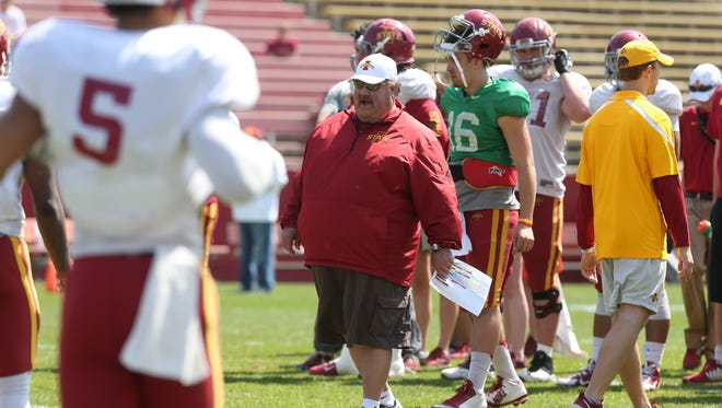 Iowa State Offensive Coordinator Mark Mangino gives instruction during a drill before the annual spring football game on Saturday, April 11, 2015 at Jack Trice Stadium.
