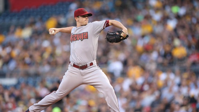 Aug 17, 2015: Arizona Diamondbacks starting pitcher Jeremy Hellickson (58) delivers a pitch against the Pittsburgh Pirates during the first inning at PNC Park.