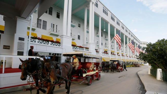 Horse drawn carriages drive by the Grand Hotel during the 2016 Mackinac Republican Leadership Conference.