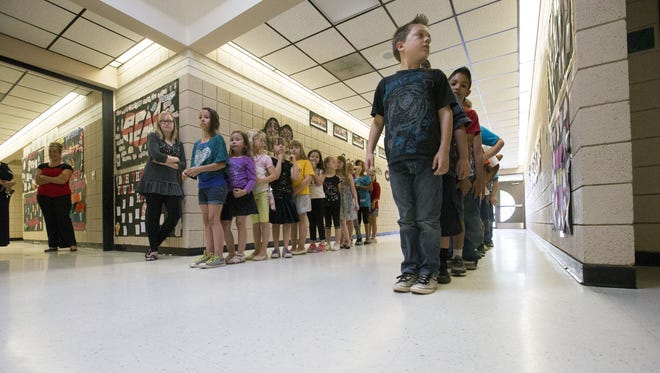 Gov. Doug Ducey's Classrooms First Initiative Council is recommending Arizona more equally fund district and charter schools.
