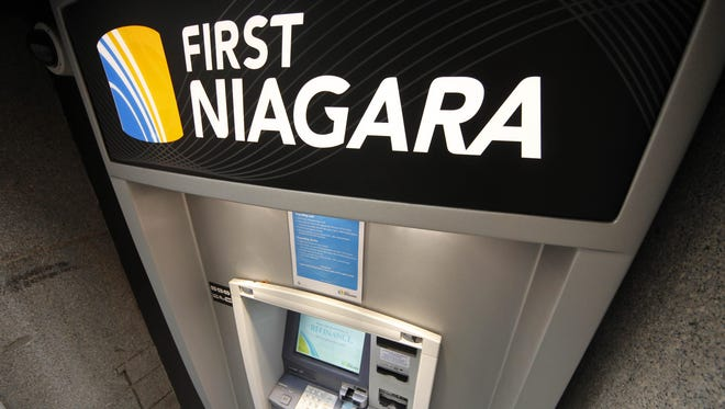 This Jan. 12, 2012 photo, shows a First Niagara Bank ATM machine in downtown Pittsburgh. First Niagara Financial Group Inc. said Friday, Jan. 20, 2012, that two other banks have agreed to purchase 27 upstate New York branches, a move that First Niagara agreed to make to satisfy antitrust concerns over its purchase of HSBC's entire upstate New York retail network. (AP Photo/Gene J. Puskar)