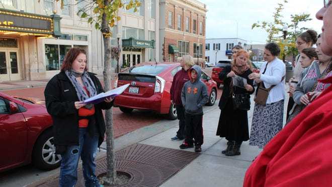 Sara Shaw, a Wausau Paranormal Research Society investigator, discusses the paranormal history of The Grand Theater in Wausau on Oct. 10, 2015. The Grand Theater is one of many stops on the WPRS Haunted Wausau Walking Tour.