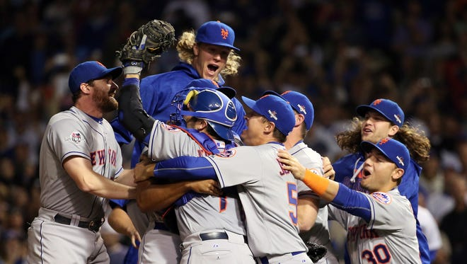 The Mets celebrate their 8-3 win Wednesday and a trip to the World Series.