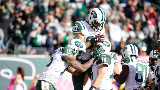 Oct 18, 2015: New York Jets wide receiver Eric Decker (87) celebrates with wide receiver Brandon Marshall (15) and quarterback Ryan Fitzpatrick (14) during his game against the Washington Redskins at MetLife Stadium. The Jets won, 34-20.