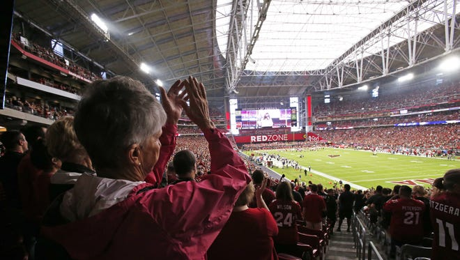 Arizona Cardinals fans cheer against the St. Louis Rams in the first half on Oct. 4, 2015 in Glendale, Ariz.