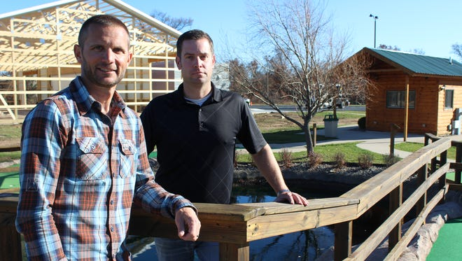 From left: Brothers David  Guld and Dylan Alwin, owners of Finishing Touch Signs, are expanding their business.