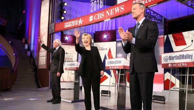 Vermont U.S. Sen. Bernie Sanders, former Secretary of State Hillary Clinton and former Maryland Gov. Martin O'Malley greet the audience before the Democratic presidential debate Saturday, Nov. 14, 2015, in Des Moines, Iowa, at Sheslow Auditorium on the campus of Drake University.