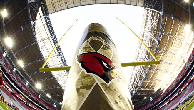 The Salute to Service logo adorns the goal post as the Arizona Cardinals hosts the Cincinnati Bengals on Nov. 22, 2015 in Glendale, Ariz. This is the first game this season to be played with the roof open.