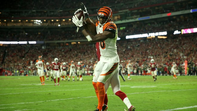 Bengals wide receiver A.J. Green turns to score but the pass was ruled incomplete late in the fourth quarter of Sunday's loss to the Cardinals.