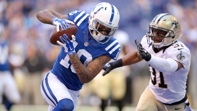 Indianapolis Colts wide receiver Donte Moncrief (10) makes a reception for a touchdown during the second half of an NFL football game Sunday, Oct. 25, 2015, at Lucas Oil Stadium. The Saints won 27-21.