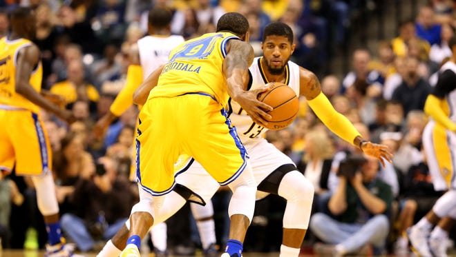Indiana Pacers forward Paul George (13) defends against Golden State Warriors forward Andre Iguodala (9) at Bankers Life Fieldhouse on Dec. 7, 2015.
