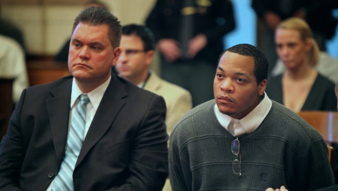 """In this 2012 photo, Rayshawn Johnson (right) listens as Judge Ralph """"Ted"""" Winkler sentences him to death. Will Welsh, one of Johnson's attorneys, sits next to him."""