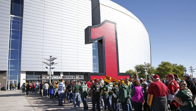 Fans wait for the doors to open for the Green Bay Packers game on Dec. 27, 2015 in Glendale, Ariz.