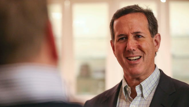 Presidential hopeful, Rick Santorum speaks to a group of Iowans at a house party on Tuesday, Dec. 29, 2015 in Waukee.