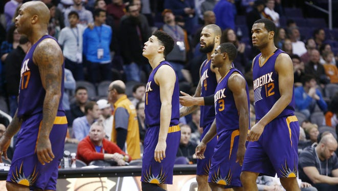 Phoenix Suns players walk off the court after losing to the Cleveland Cavaliers on Monday Dec. 28, 2015 at Talking Stick Resort Arena, AZ.