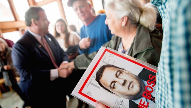 A visitor holds a Time magazine depicting Republican presidential candidate Chris Christie, New Jersey's governor, after he spoke Dec. 29, 2015, at Elly's Tea and Coffee House in Muscatine, Iowa.