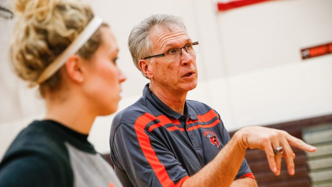 Coach Kristin Raker and father, assistant coach Gary Raker, talk Jan. 7 about the next drill to run during girls basketball practice at Beech Grove High School.