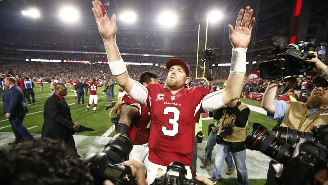 Arizona Cardinals' Carson Palmer waves to his family after defeating the Green Bay Packers in overtime during the NFC Divisional Playoffs on Jan. 16, 2016 in Glendale, Ariz.