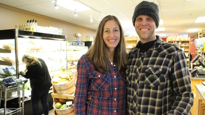 Owners Megan Curtes Korpela, left, and Kevin Korpela, right, stand in Downtown Grocery's temporary market in the Wausau Center mall Friday. The new location opened Jan. 29.