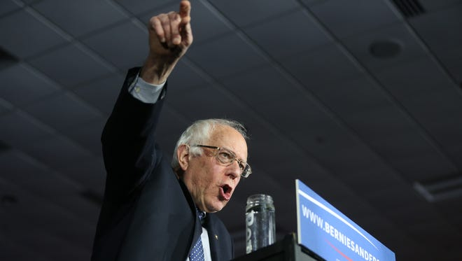 Presidential hopeful Bernie Sanders speaks to a crowd of supports on caucus night, Monday, Feb. 1, 2016, in Des Moines.
