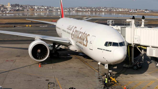 An Emirates Airline Boeing 777-200LR at a gate at Boston Logan International Airport on March 10, 2014.
