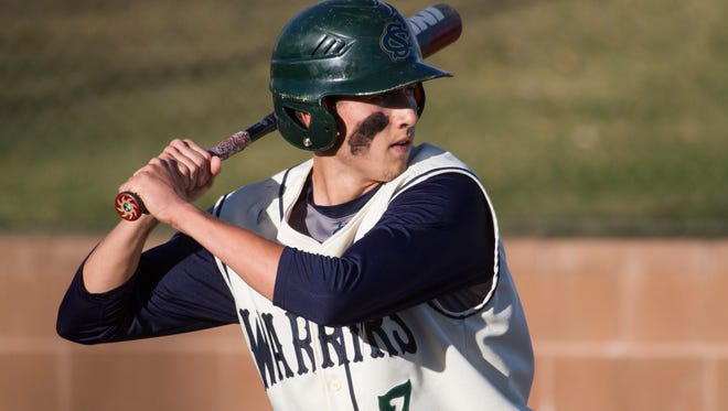 Snow Canyon's Garrett Hyde waits for a pitch against Cimarron Thursday night. The Warriors lost, 7-2, to the Spartans.