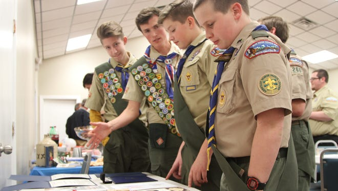 Thomas Wade, second from left, offers some guidance to fellow Boy Scouts.