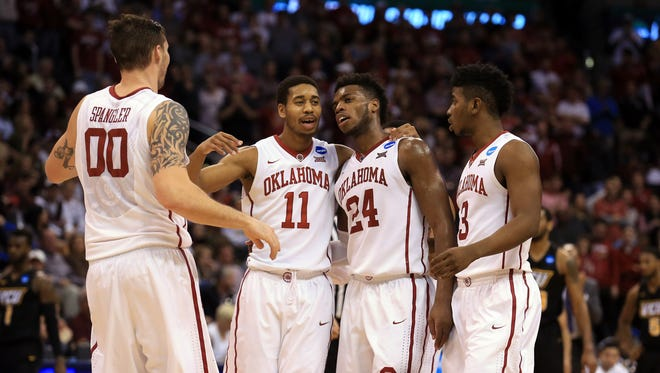 Three of Oklahoma's core four, Ryan Spangler (00), Isaiah Cousins (11) and Buddy Hield.