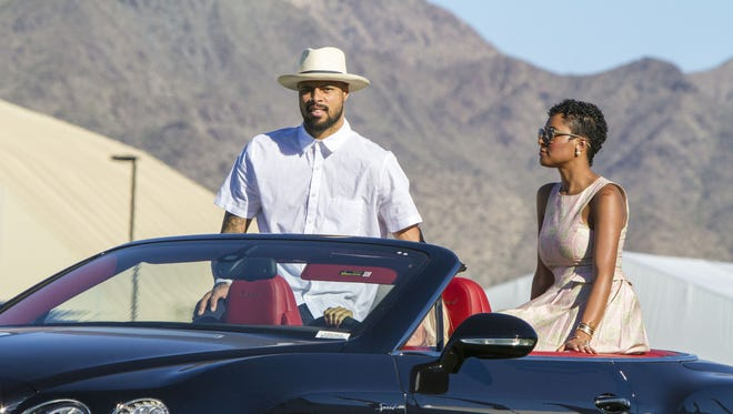 Suns center Tyson Chandler and wife Kimberly arrive to throw in the ball during the championship game at Bentley Scottsdale Polo Championships at WestWorld of Scottsdale on Saturday, Oct. 24, 2015.