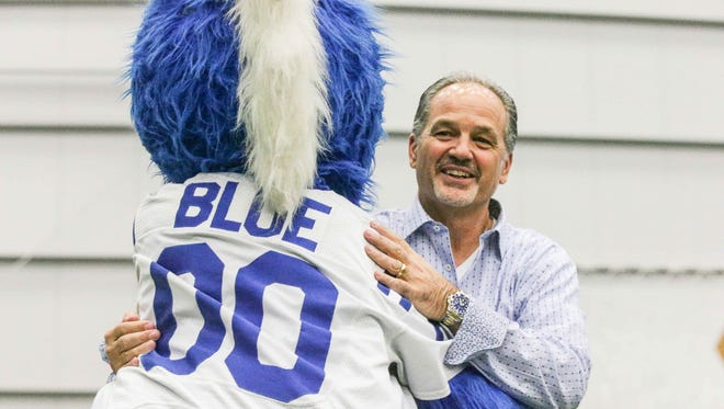 Colts Head Coach Chuck Pagano is greeted by Blu and rest of the Chuckstrong Starting Lineup after running through the horse tunnel during the Chuckstrong Tailgate Gala Indiana Farm Bureau Football CenterThursday April 21st, 2016. Hosted by the Indianapolis Colts and Head Coach Chuck Pagano, the  Gala raised awareness and funds for cancer research at the Indiana University Melvin and Bren Simon Cancer Center.
