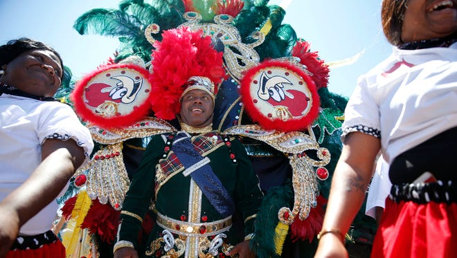 King Woody of the King Woody Social Aid & Pleasure Club walks in a symbolic jazz funeral for New Orleans music icon Allen Toussaint at the New Orleans Jazz and Heritage Festival on Saturday in New Orleans.