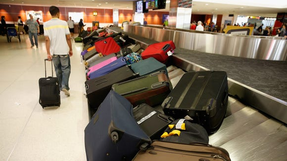 Bags sit on a carousel in the Southwest baggage claim
