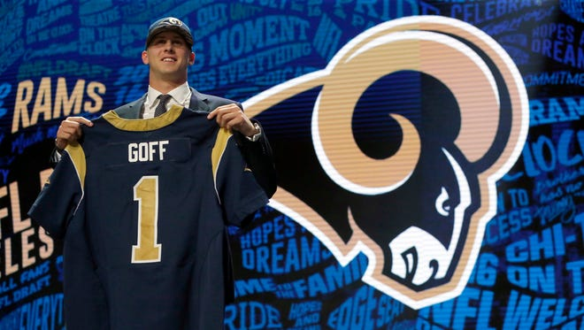 Cal's Jared Goff poses for photos after being selected by the Los Angeles Rams as the first pick in the first round of the 2016 NFL football draft.