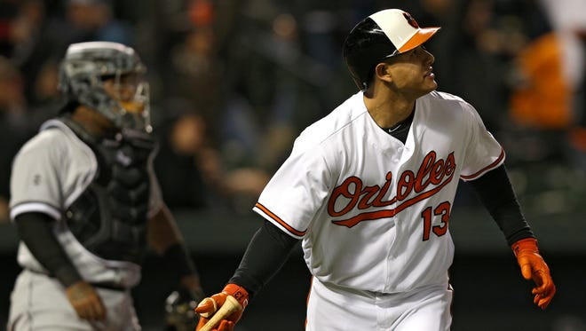 Manny Machado watches his grand slam against the White Sox in the sixth inning at Oriole Park at Camden Yards.