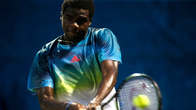 Frances Tiafoe takes on Ryan Harrison during their singles match in the semifinal round of the USTA Tallahassee Tennis Challenger on Friday.