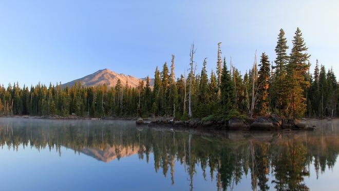 Summit Lake is seen below Diamond Peak in Deschutes National Forest southeast of Oakridge.