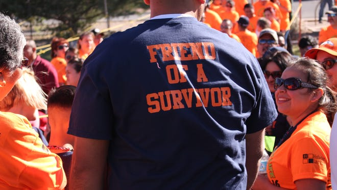 """A t-shirt reads, """"Friend of  a survivor,"""" at the 11th annual Celebration of Life Cancer Walk held Saturday at Voiers' Park.  Nearly 1,200 people attended the fundraiser for the Cancer Support Group of Deming and Luna County, Inc. Many walked in memory of loved ones and for those who are currently battling cancer."""