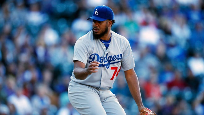 Los Angeles Dodgers relief pitcher Kenley Jansen reacts after retiring the Colorado Rockies' Trevor Story for the final out in the ninth inning April 24, 2016, in Denver.