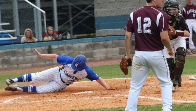 Clarksville Academy's Michael Conn slides into home for a Cougars run during their Region 5-A baseball semifinal against Eagleville on Tuesday in Clarksville. Clarksville Academy advanced with a 7-0 victory at Wes Smith Field.