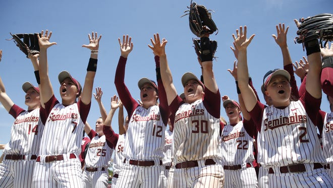 FSU's Softbal team celebrates after going undefeated in the NCAA Regionals at JoAnne Graf Field over the weekend.