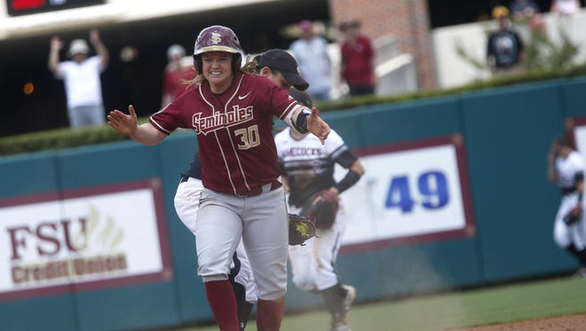 FSU's Jessica Warren signals back to her teammates after hitting an 2RBI double during their NCAA Regional game against South Carolina at JoAnne Graf Field on Saturday.