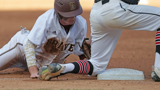 Brebeuf's Jake Scott slides into second base safely in the 2016 Marion County Tournament  at Victory Field.
