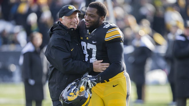 Iowa's Darian Cooper with defensive line coach Reese Morgan during the Iowa vs. Purdue game at Kinnick Stadium in Iowa City, Saturday, Nov. 21, 2015.