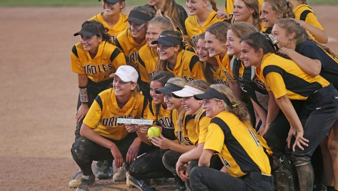 The Avon Orioles pose for photos with the game ball after defeating the Decatur Hawks during the High School Softball Regionals, Tuesday May 31st, 2016. The Avon Orioles beat the Decatur Hawks during the High School Softball Regionals, at Decatur Central.