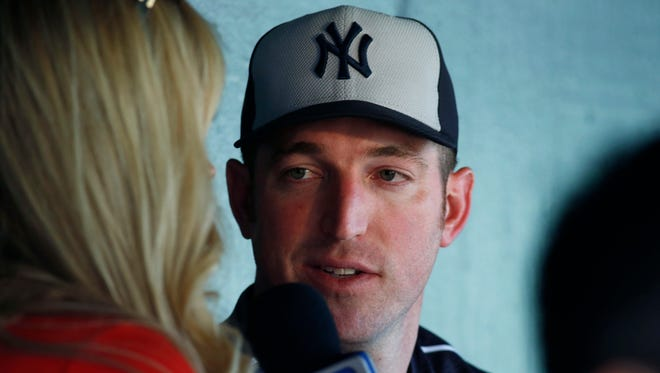 New York Yankees first baseman Ike Davis talks to a reporter prior to a baseball game against the Colorado Rockies on Tuesday, June 14, 2016, in Denver.